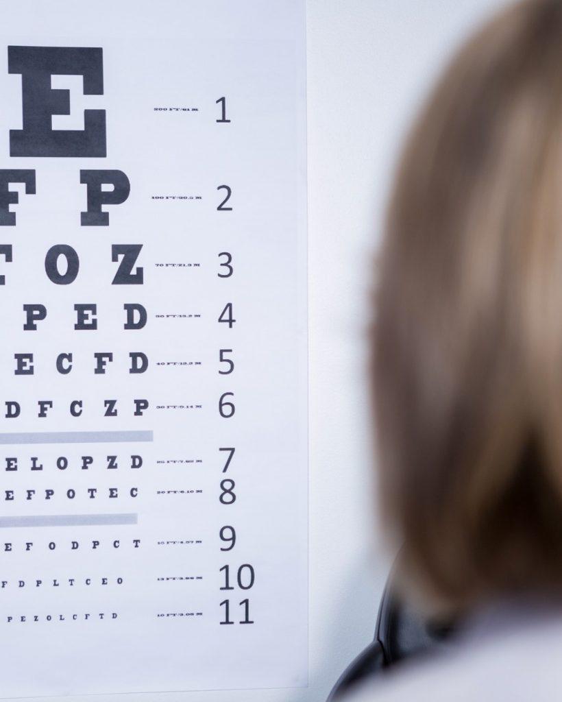 optometrist-looking-at-eye-chart.jpg