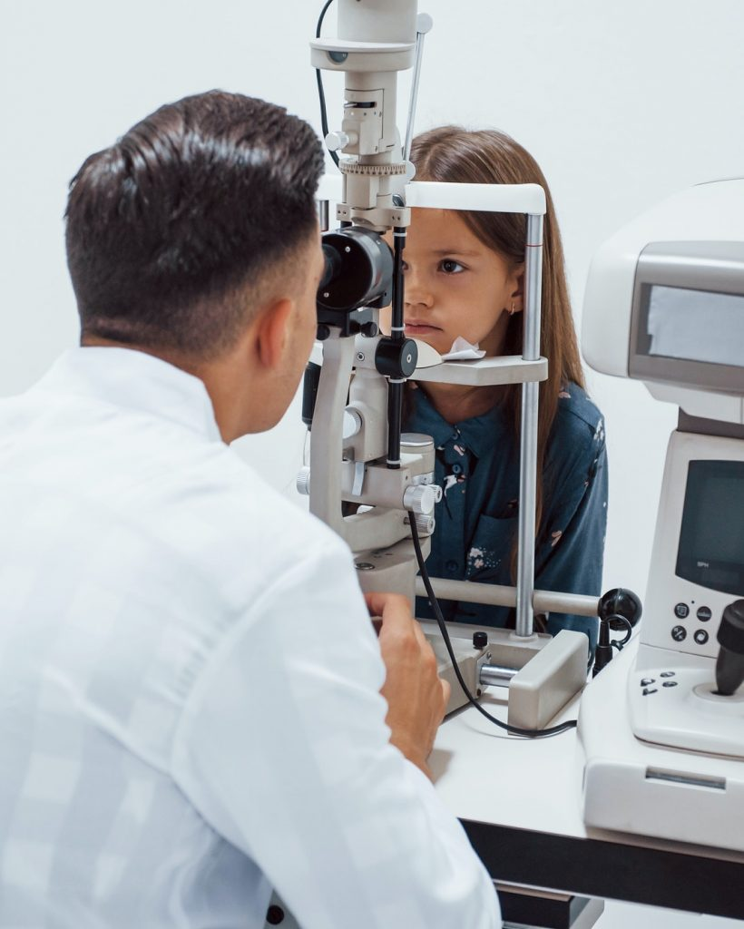 young-ophthalmologist-is-with-little-female-visitor-in-the-clinic.jpg